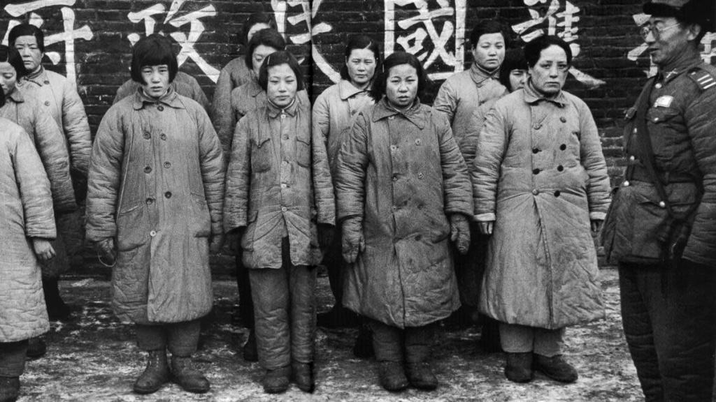 A Nationalist officer guarding women prisoners likely to be comfort women used by the Communists, 1948. (Credit: Jack Birns, The LIFE Picture Collection, Getty Images)